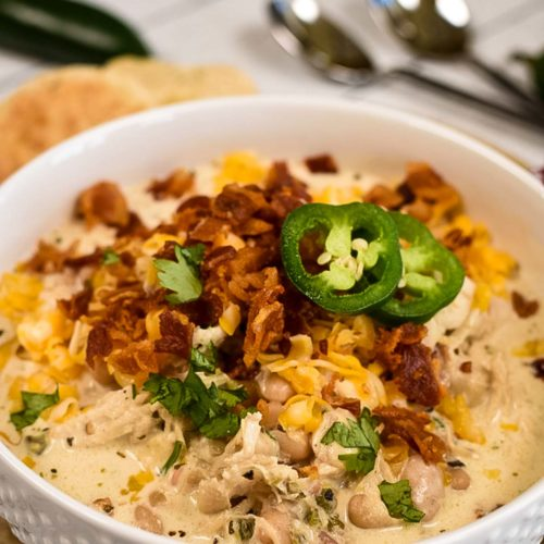 Bowl of jalapeno soup with toppings.
