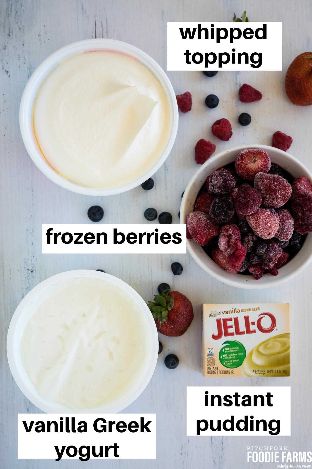 An image with ingredients needed to make cheesecake salad; frozen berries, vanilla yogurt, pudding mix, and whipped topping.