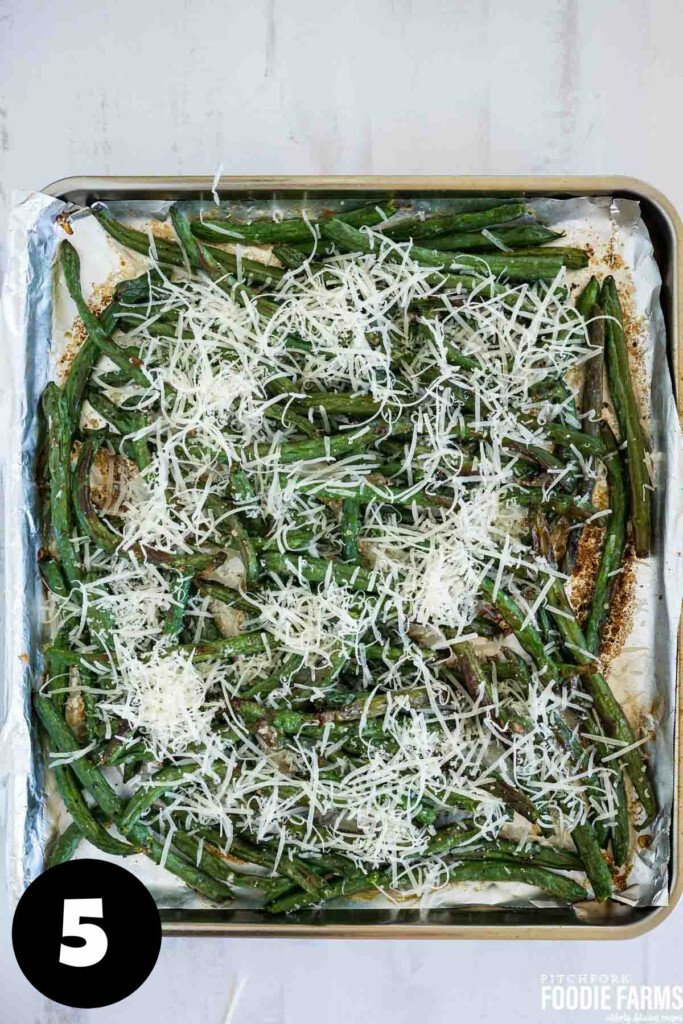 Roasted green beans with grated parmesan cheese on top.
