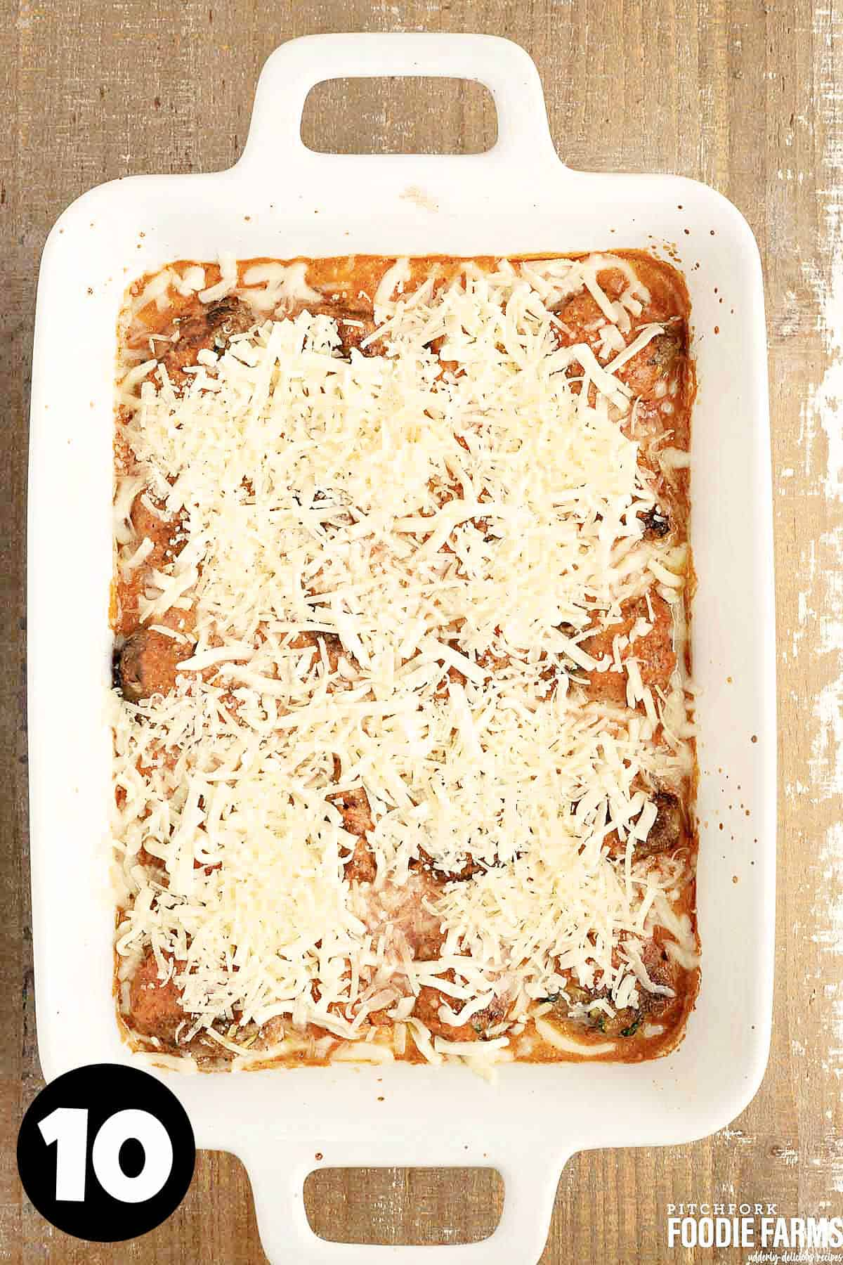 Beef and zucchini meatballs in tomato sauce topped with mozzarella and parmesan cheese.