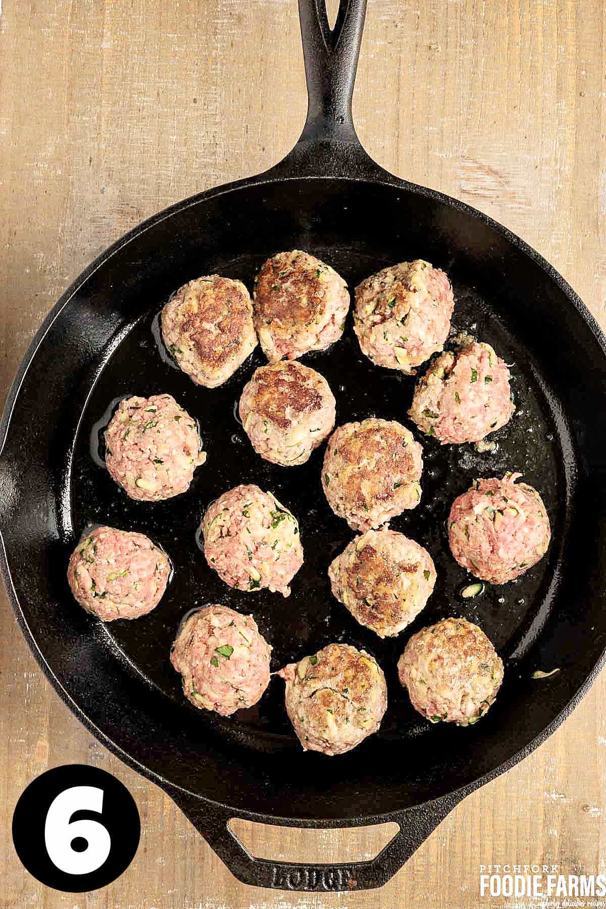 Meatballs in a cast iron skilled.