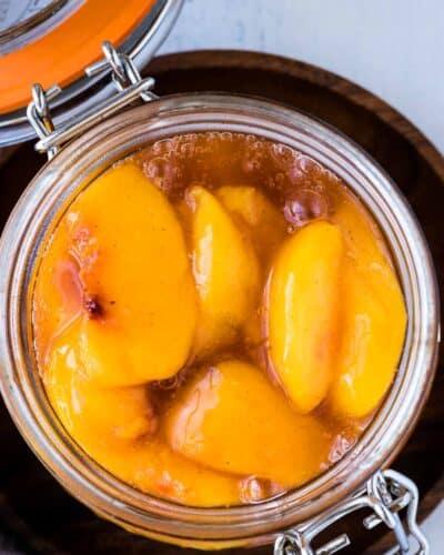 A jar with fresh peach pie filling.